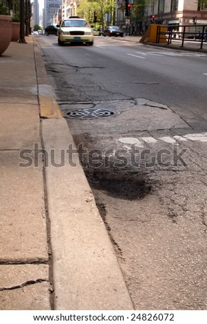 Pothole in city street - stock photo