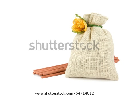 Potpourri sachet bag with aroma sticks isolated on white - stock photo