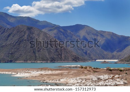 Potrerillos dam.A large dam on the Mendoza River forms an artificial lake that measures 12 km in length and 3 km in maximum width. Province of Mendoza. Argentina - stock photo