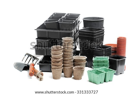 pots boxes briquette for gardening in white background - stock photo