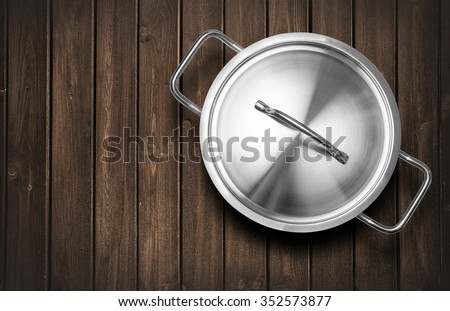 Pots  on a wooden kitchen bench with copy space - stock photo