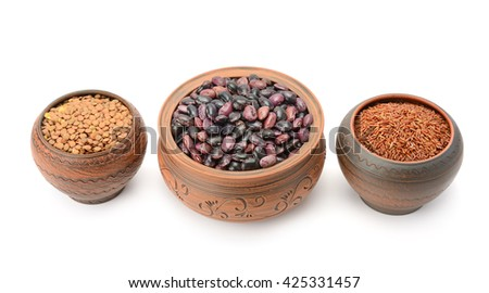 Pots with beans, rice and lentils isolated on white background - stock photo