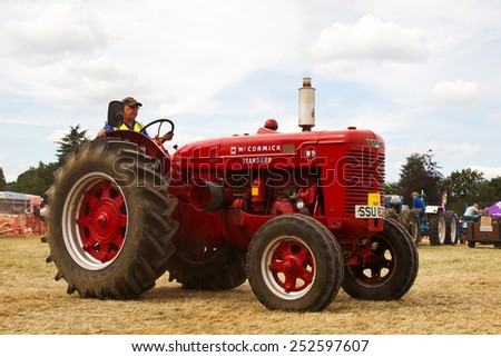 POTTEN END, UK - JULY 27: A McCormick standard tractor is paraded around the main arena as part of the agricultural machinery show at the Dacorum Steam & Country fair on July 27, 2014 in Potten End - stock photo
