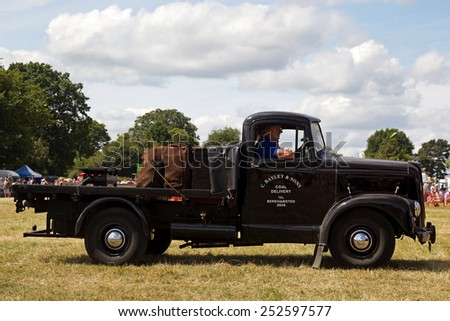 POTTEN END, UK - JULY 27: A vintage coal delivery flatbed truck  gives a display to the public in the main arena at the Dacorum Steam & Country fair on July 27, 2014 in Potten End - stock photo