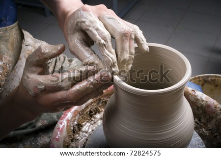 potter on the potters wheel - stock photo