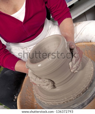 Potter's hands - stock photo
