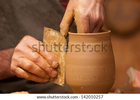 Potter shaping clay - stock photo