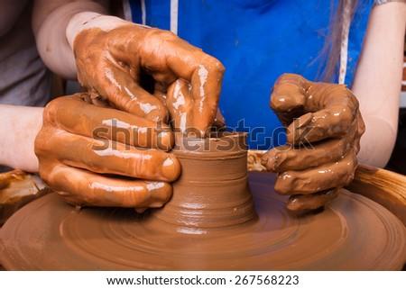 Potter teaches how make clay pot - stock photo