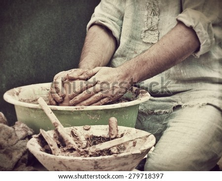 Potter works. Crockery creation process in pottery on potters' wheel. - stock photo