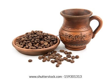 pottery and coffee beans isolated on white background - stock photo
