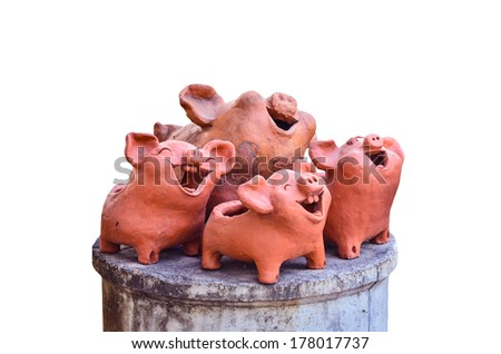 Pottery pig laughing on white background - stock photo