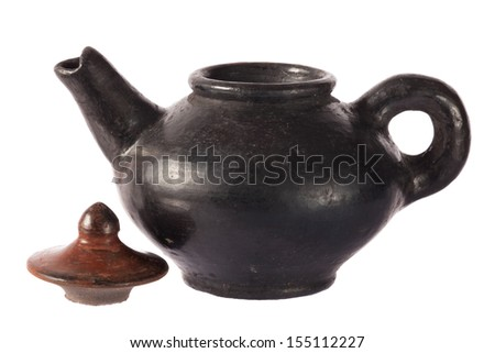 Pottery teapot traditional style on white background - stock photo