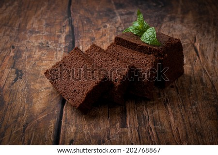 pound cake over wooden background - stock photo