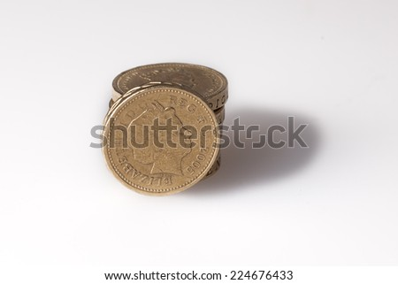 Pound coins stack shot in studio - stock photo