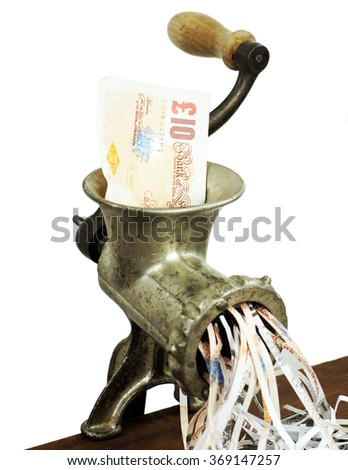 Pound note in a meat grinder - stock photo
