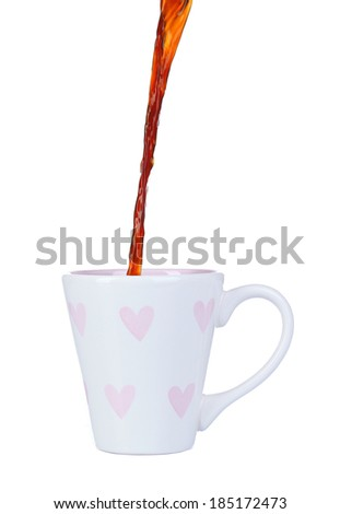 Pour coffee into cup, isolated on white - stock photo