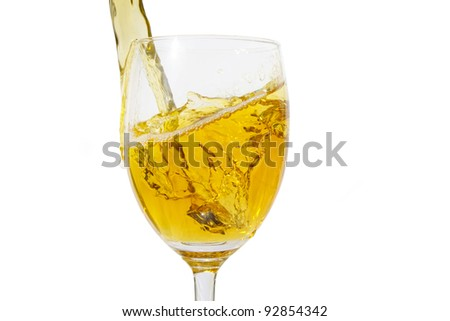 Pour the wine into the glass transparent. - stock photo