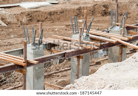 Poured cement with steel poles for construction - stock photo