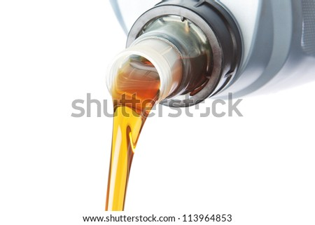 Poured industrial oil. On a white background. - stock photo