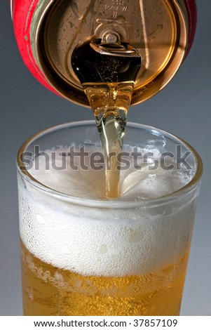 Pouring beer in a glass. - stock photo