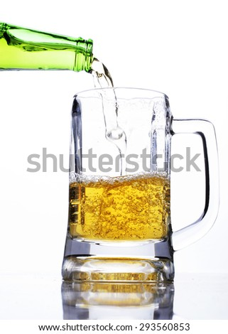 Pouring beer into a glass for celebrate international beer days - stock photo