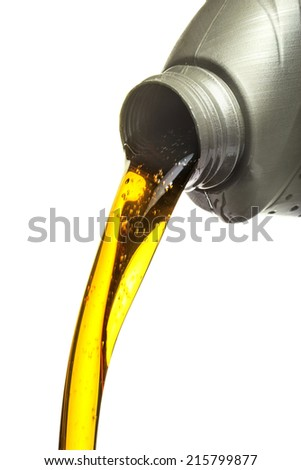 pouring engine oil from its plastic container - stock photo