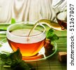Pouring Herbal Tea - stock photo