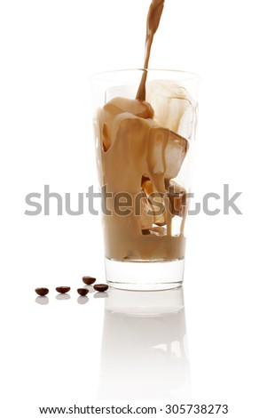 Pouring ice coffee into glass with ice cubes isolated on white background. Culinary coffee drinking.  - stock photo