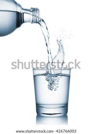 pouring natural water on glass with splashing - stock photo