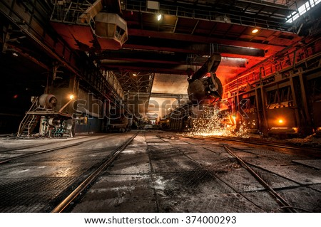 Pouring of liquid metal in open-hearth furnace - stock photo