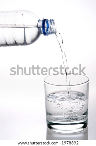 pouring plain water into a glass - stock photo