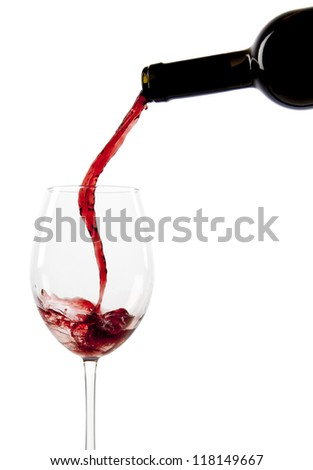 Pouring red wine in a glass isolated - stock photo