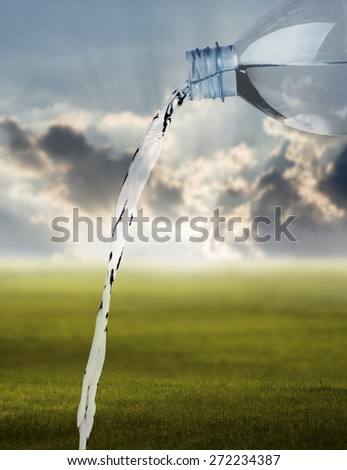 Pouring water against the nature background, Freshness concept - stock photo