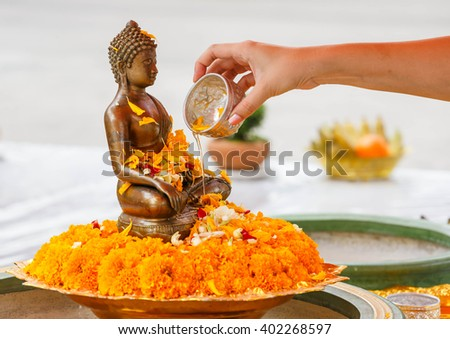 """pouring water for Buddha """" SONG KARN """" festival - stock photo"""