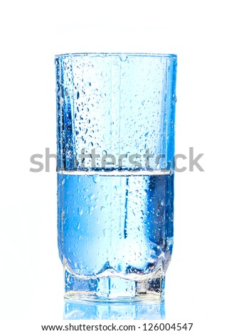 Pouring water into glass  and Glass  isolated on a white background - stock photo