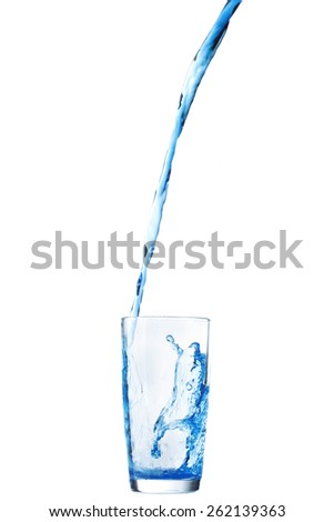 Pouring water into glass isolated on white background - stock photo
