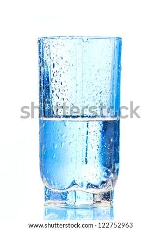 Pouring water into glasson and Glass of water isolated on a white background - stock photo