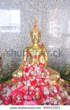 Pouring water over Buddha to signify cleansing for the New Year. Songkran festival Bangkok Thailand, selective focus on Buddha's chest - stock photo