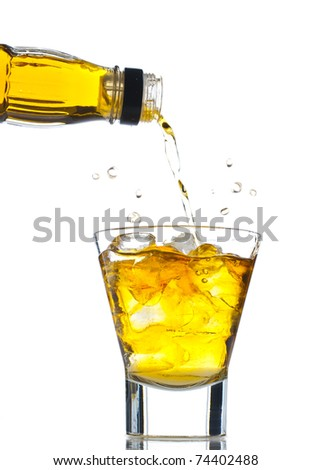 Pouring whiskey on the rocks - stock photo