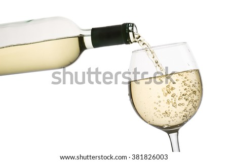 pouring white wine into glass, on white background - stock photo