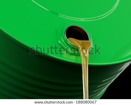 Pouring yellow liquid or gasoline from drum - stock photo