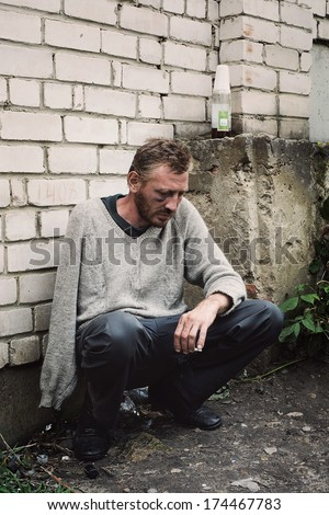 Poverty and alcohol abuse as a social problem - stock photo