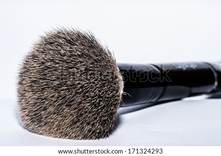 Powder brush at a white backround - stock photo