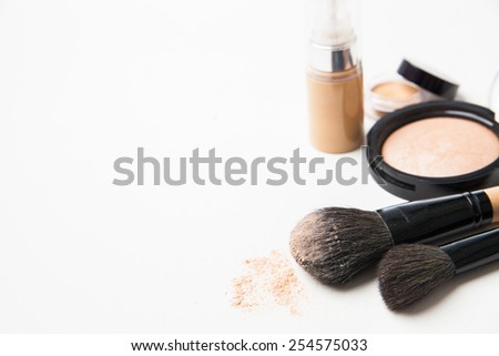 Powder, foundation and brushes isolated on the white background - stock photo
