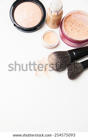 Powder, foundation and brushes isolated on the white background top  view - stock photo