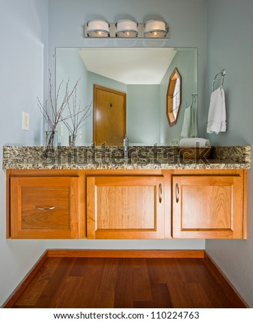 Powder room interior with floating cabinet. - stock photo