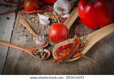 Powder spices on spoons in black wooden table background - stock photo