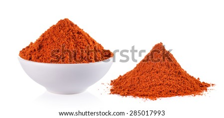 Powdered dried red pepper in a white bowl on white background - stock photo
