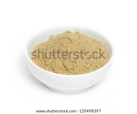 Powdered ginger in a bowl white isolated - stock photo