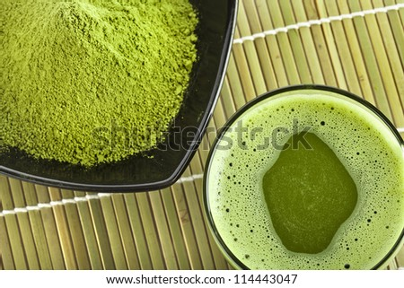 powdered green tea on bamboo napkin texture - stock photo